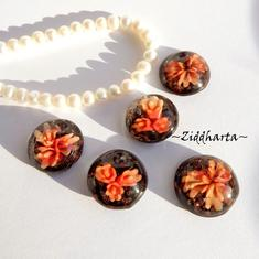 1 LampWork Borrad Cabochon: Svart Orange Blossom 20mm diam.