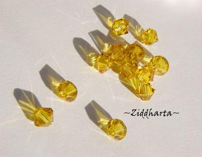 Swarovski 4mm Bicone - Sunflower - 8st